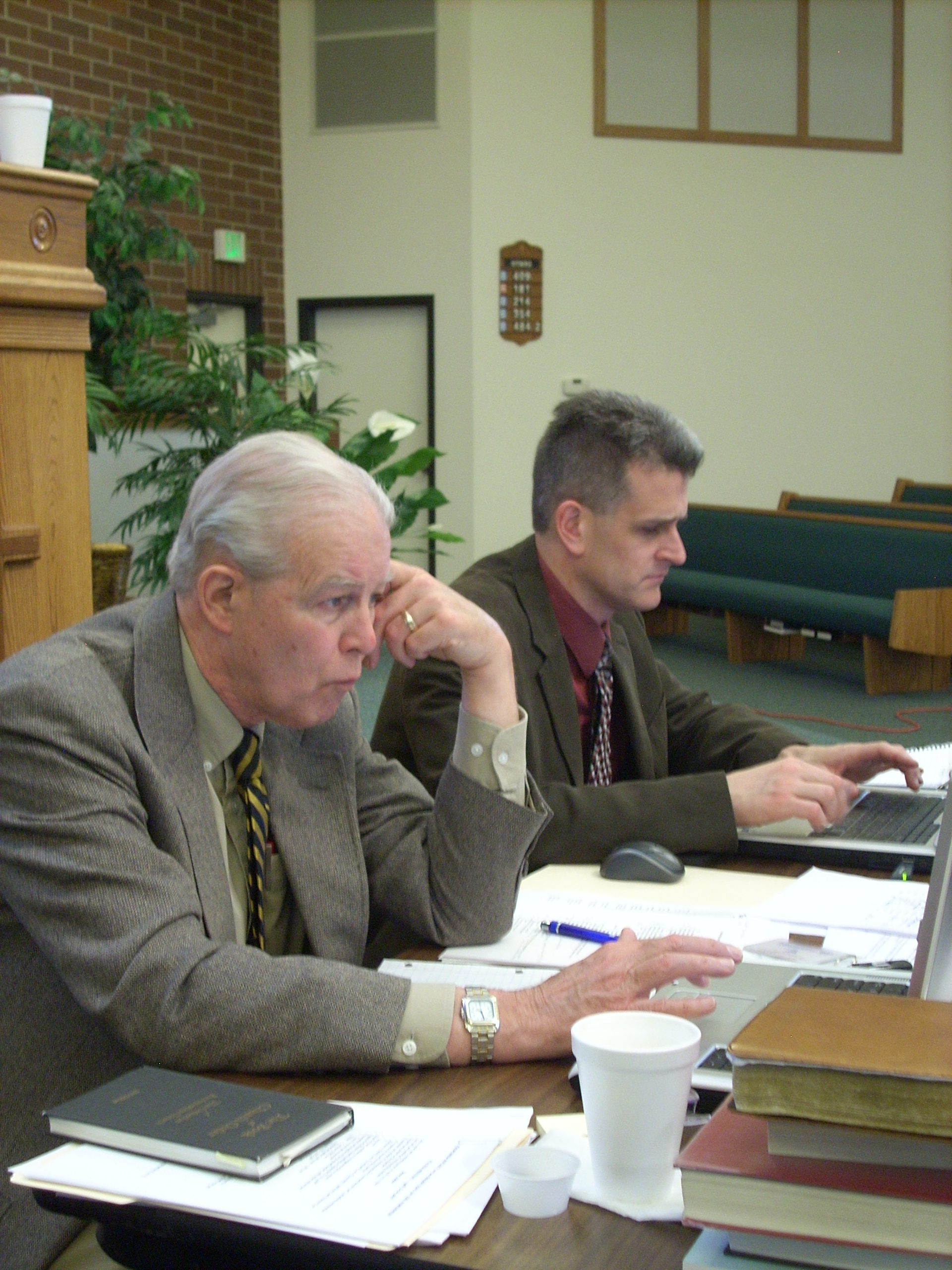 PNW_2010-04 033.jpg - The Stated Clerk, Donald Poundstone, and Assistant Clerk, Rob Van Kooten, hard at work . . .