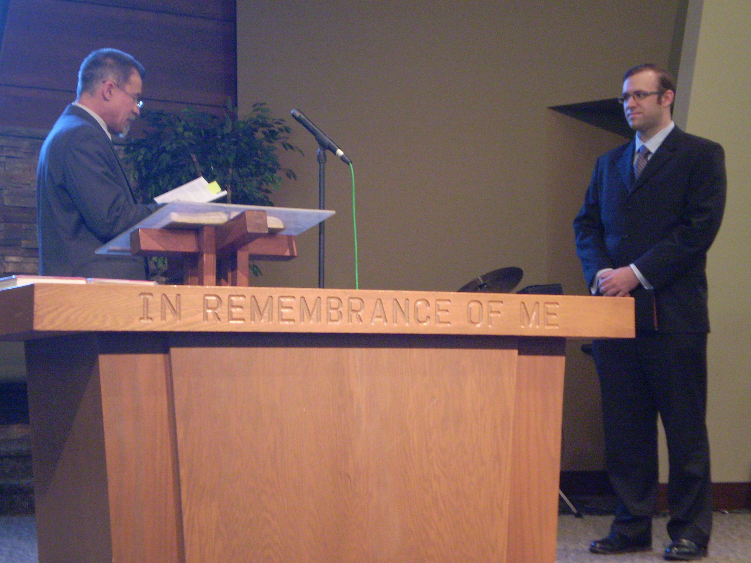 Matt_Barker_Vows.JPG - Matt Barker taking his ordination vows, special meeting of the Presbytery of the Northwest, May 14, 2010, Kent, Washington